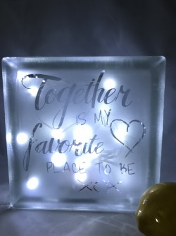 "$74 - 8"" x 8"" glass block comes decorated with lights, ribbon and your design sand carved into the glass.  Great for table centerpiece as both sides can be sand carved."