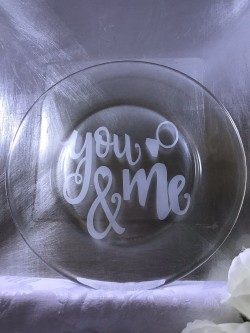 "$15 - Cake Plate 7.5"" round with ""You & Me"" pattern sand carved into the plate."