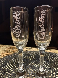 $30 - Champagne Flutes with the words Bride/Groom in script.  6.25 oz.